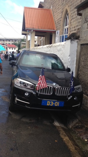 An escort vehicle for the US Ambassador is parked outside St. Peter's Church in Gouyave.