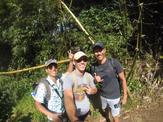 Don Nguyen, myself, and Kevin Wang posing with a Mona monkey at Grand Etang National Park